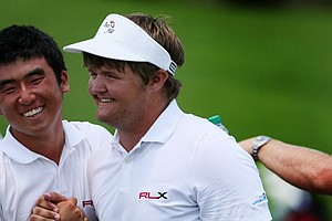 Doug Ghim congratulates Cody Proveaux after Thursday's single matches at the 2012 Wyndham Cup.