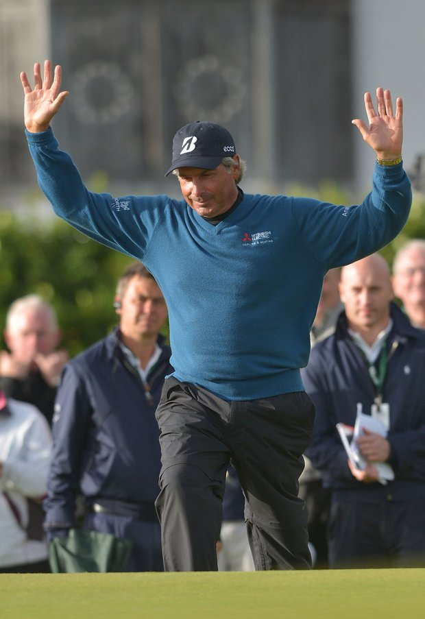 Fred Couples walks onto the 18th green to receive the Senior Open Claret Jug during The Senior Open Championship.