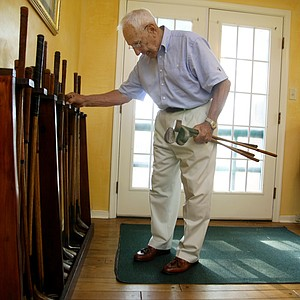 Lewis Kellar picks out some hickory clubs at the Oakhurst Links.