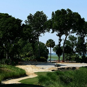 A worker with MacCurrach Golf Construction floats the green at No. 17 during renovations at Old Tabby Links on Spring Island in South Carolina.
