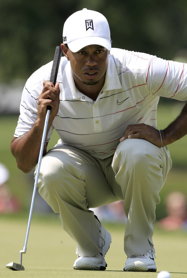 Tiger Woods lines up his putt on the second hole during the first round of the Bridgestone Invitational golf tournament at Firestone Country Club, Thursday, Aug. 2, 2012, in Akron, Ohio.