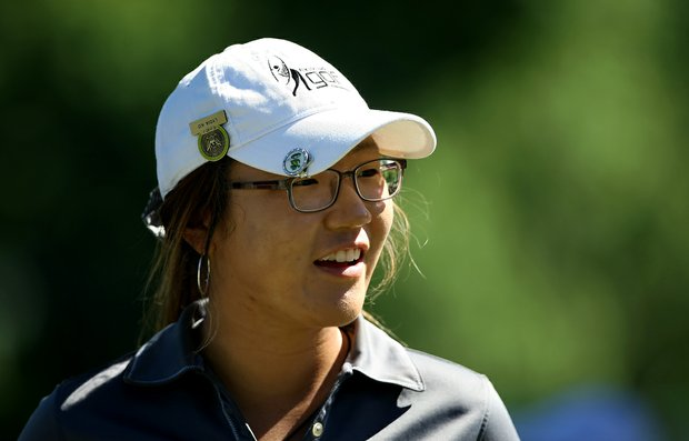 Lydia Ko of New Zealand leads after the first round of stroke play at the 2012 U. S. Women's Amateur Championship at The Country Club. She posted a 66 to take the lead.