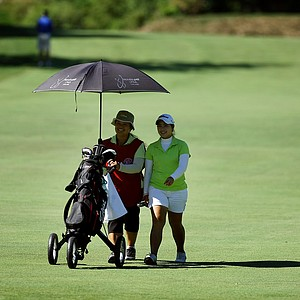 Moriya Jutanugarn alongside her mother/caddie,  Narumon, during Round 1 of the 2012 U. S. Women's Amateur Championship.