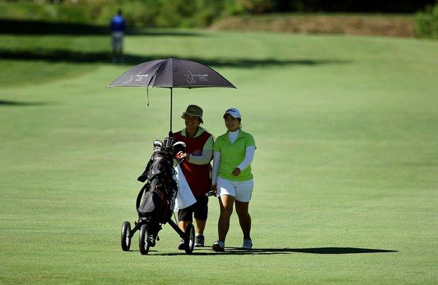 Moriya Jutanugarn alongside her mother/caddie,  Narumon, during Round 1 of the 2012 U. S. Women's Amateur Championship.