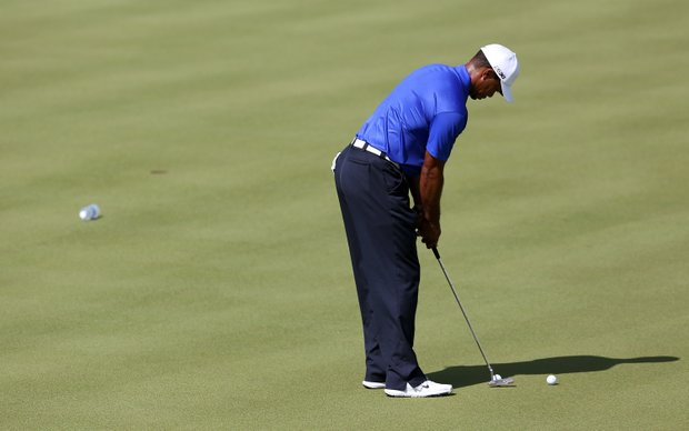 Tiger Woods practices putting during a practice round of the 2012 PGA Championship at the Ocean Course.