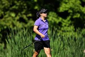 Chirapat Jao-Javanil, the current NCAA Champion, walks down No. 11 during the second round of stroke play at the 2012 U. S. Women's Amateur Championship.