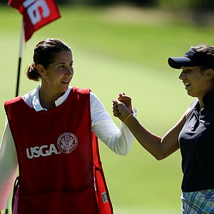 Annie Dulman, right, with her mom/caddie, Laura after making par at No. 16 during the second round of stroke play at the 2012 U. S. Women's Amateur Championship.