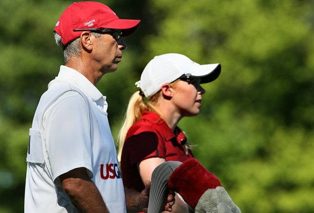 Alabama head coach Mic Potter caddied for Stephanie Meadow who missed the cut after shooting 80 during the second round of stroke play at the 2012 U. S. Women's Amateur Championship.