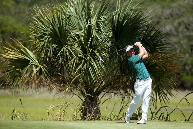 Luke Donald hits a tee shot during a practice round of the 2012 PGA Championship at the Ocean Course.