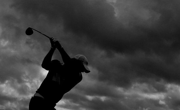 Rory McIlroy plays through dark clouds as storms entered the area during a Tuesday practice round at the Ocean Course.