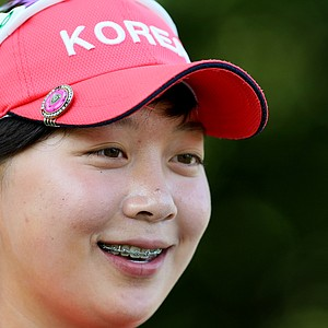 Hyo-Joo Kim is all smiles after defeating Megan Khang 7&6 during the Round of 64 at the 112th U. S. Women's Amateur Championship.