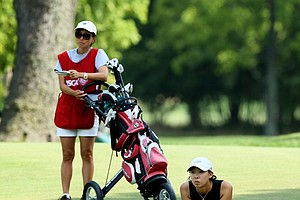 Nicole Zhang waits in the fairway at No. 12 during the Round of 64 at the 112th U. S. Women's Amateur Championship.