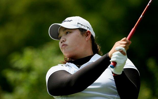 Ariya Jutanugarn hits her tee shot at No 1 during the Round of 64 at the 112th U. S. Women's Amateur Championship.