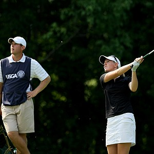 Amy Anderson hits a shot at No. 17 as her brother/caddie, Nathan, watches during the Round of 64 at the 112th U. S. Women's Amateur Championship. Anderson defeated Moriya Jutanugarn, the runner-up at last year's Amateur.