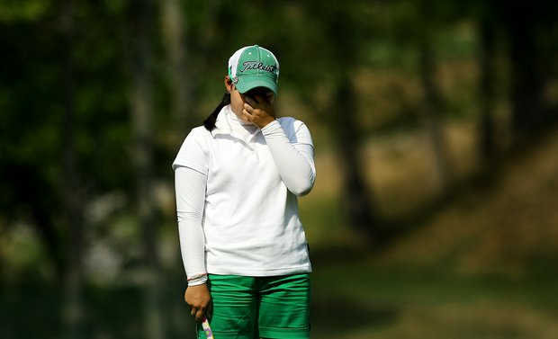 Moriya Jutanugarn reacts to missing her putt at No. 17 during the Round of 64 at the 112th U. S. Women's Amateur Championship. Jutanugarn lost her match and does not advance to the Round of 32.