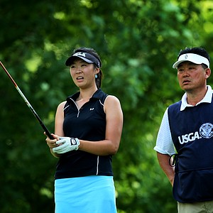 Erynne Lee with her father Brian on the bag looks down the fairway at No. 13 during the Round of 64 at the 112th U. S. Women's Amateur Championship. Lee defeated the current U. S. Girls Champion, Minjee Lee of Australia.