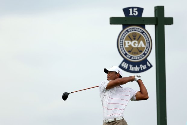 Tiger Woods plays the first two rounds with defending champion Keegan Bradley and 2010 champion Martin Kaymer.
