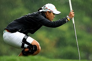Cyna Rodriguez lines up her putt at No. 12 as the rain begins to fall heavy during the Round of 32 at the 112th U. S. Women's Amateur Championship.