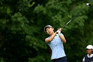 Nicole Zhang watches her tee shot at No. 13 during the Round of 32 at the 112th U. S. Women's Amateur Championship at The Country Club in Cleveland. Zhang defeated Cyna Rodriguez, 4&3.