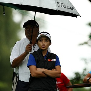 Jayvie Marie Agojo whistles while she waits at No. 13 during the Round of 32 at the 112th U. S. Women's Amateur Championship.