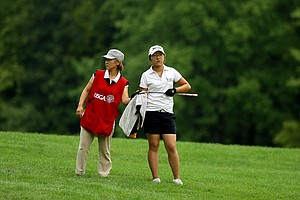 Lydia Ko with her mom/caddie Tina, during the Round of 32 at the 112th U. S. Women's Amateur Championship.
