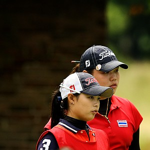 Moriya Jutanugarn caddied for her sister, Ariya during the Round of 32 at the 112th U. S. Women's Amateur Championship.