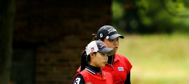 Moriya Jutanugarn caddied for her sister, Ariya during the Round of 32 at the 112th U. S. Women's Amateur Championship.