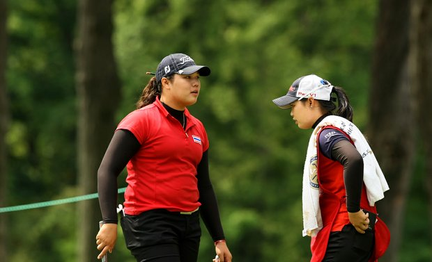 Ariya Jutanugarn, left,  with her sister Moriya who lost in the Round of 64, caddied during the Round of 32 at the 112th U. S. Women's Amateur Championship.