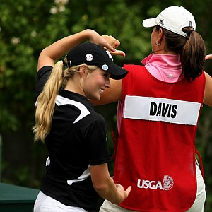 Sarah Beth Davis points to her Texas A&M coach, Trelle McCombs, who caddie for her at the 112th U. S. Women's Amateur Championship. Davis lost in the Round of 32.