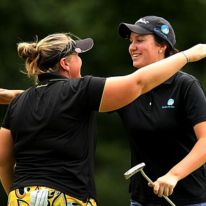 Breanna Elliott gives fellow Australian Ashlee Dewhurst a hug after their match went 20 holes during the Round of 32 at the 112th U. S. Women's Amateur Championship. Elliott lost to Dewhurst.