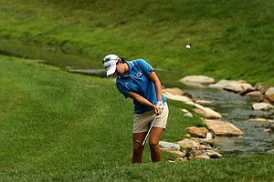 Hyo-Joo Kim of Korea hits her second shot up to the par-3 ninth hole during the Round of 16 at the 112th U. S. Women's Amateur Championship.