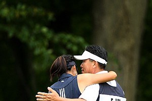 Erynne Lee hugs her father/caddie Brian after they won their match agains Austin Ernst during the Round of 16 at the 112th U. S. Women's Amateur Championship. Lee will face Ariya Jutanugarn in the Quarterfinals.