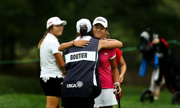 Celine Boutier of France is hugged by her caddie after losing to Lydia Ko of New Zealand during the Round of 16 at the 112th U. S. Women's Amateur Championship.