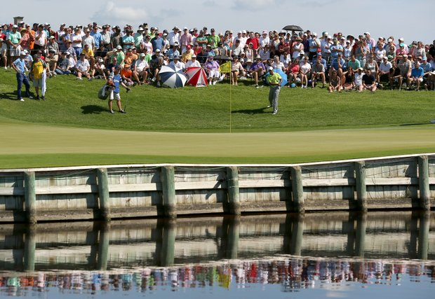 Tiger Woods of the United States hits a shot onto the 17th green during Round One of the 94th PGA Championship at the Ocean Course on August 9, 2012 in Kiawah Island, South Carolina.