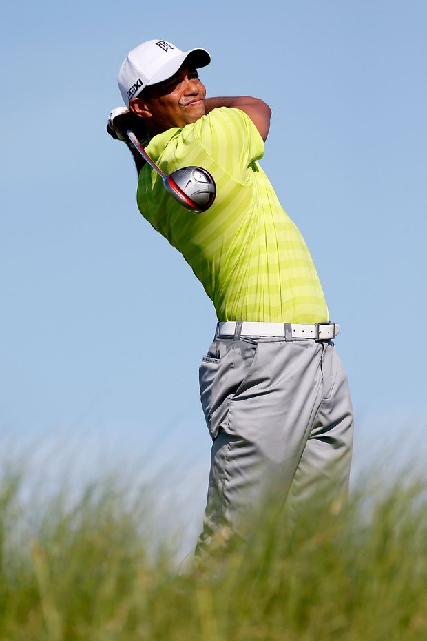 Tiger Woods of the United States hits off the 15th tee during Round One of the 94th PGA Championship at the Ocean Course on August 9, 2012 in Kiawah Island, South Carolina.