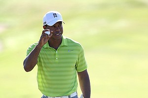 Tiger Woods of the United States gestures after finishing the 12th hole during Round One of the 94th PGA Championship at the Ocean Course on August 9, 2012 in Kiawah Island, South Carolina.