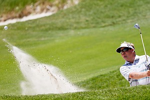 Carl Pettersson hits out of a bunker on the 17th hole during Round One of the 94th PGA Championship at the Ocean Course on August 9, 2012 in Kiawah Island, S.C.