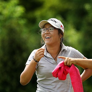 Lydia Ko, 15, with her mother/caddie, Tina during the quarterfinals at the 112th U. S. Women's Amateur Championship.