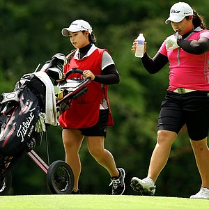 Moriya Jutanugarn, left, and Ariya Jutanugarn, right, during the quarterfinals at the 112th U. S. Women's Amateur Championship.