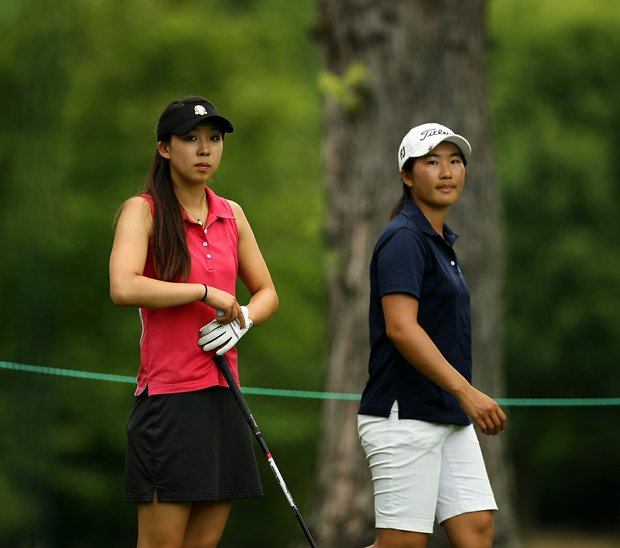Nicole Zhang, left, defeated Su-Hyun Oh, right, during the quarterfinals at the 112th U. S. Women's Amateur Championship.