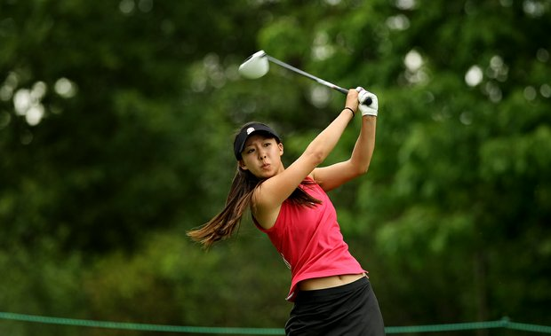 Nicole Zhang hits her tee shot at No. 8 during the quarterfinals at the 112th U. S. Women's Amateur Championship. Zhang defeated Sy-Hyun Oh.