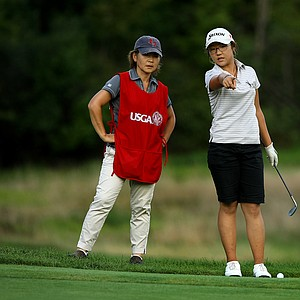 Lydia Ko, 15, with her mother/caddie Tina during the quarterfinals at the 112th U. S. Women's Amateur Championship.