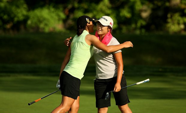 Lydia Ko, right, hugs Paula Reto, left, after their match during the quarterfinals at the 112th U. S. Women's Amateur Championship. Reto lost to Lydia Ko, 3&1.