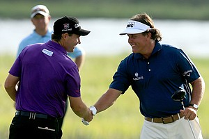 Padraig Harrington (left) and Phil Mickelson shake hands on the tenth tee during Round Two of the 94th PGA Championship at the Ocean Course on August 10, 2012 in Kiawah Island, S.C.