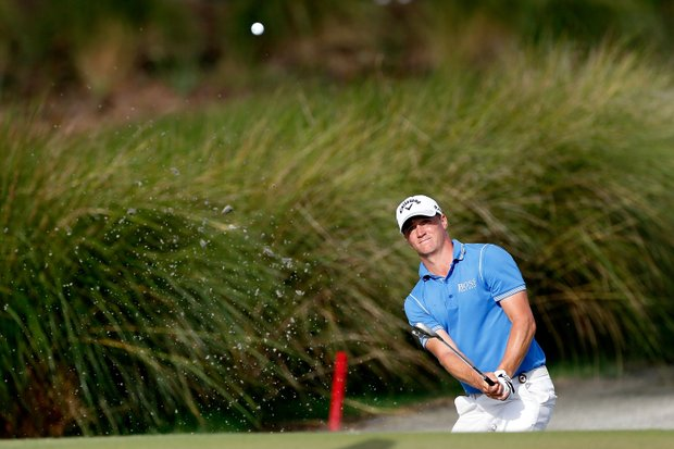 Alex Noren hits out of the sand on the first hole during Round Two of the 94th PGA Championship at the Ocean Course on August 10, 2012 in Kiawah Island, S.C.