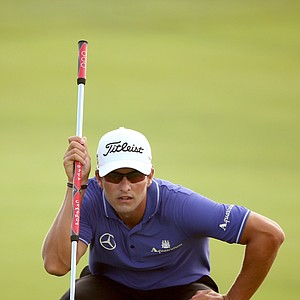 Adam Scott lines up a putt on the 11th green during Round Two of the 94th PGA Championship at the Ocean Course on August 10, 2012 in Kiawah Island, S.C.