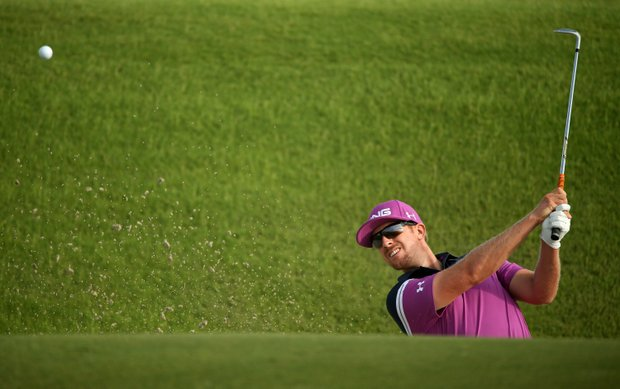 Hunter Mahan hits out of the sand on the tenth hole during Round Two of the 94th PGA Championship at the Ocean Course on August 10, 2012 in Kiawah Island, S.C.