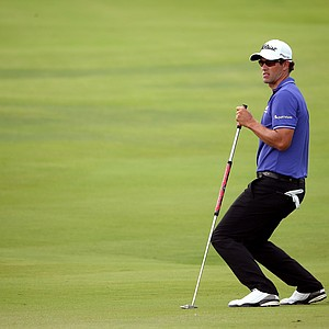 Adam Scott reacts after missing a putt on the 13th green during Round Two of the 94th PGA Championship at the Ocean Course on August 10, 2012 in Kiawah Island, S.C.