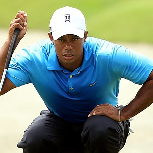 Tiger Woods lines up a putt on the first green during Round Two of the 94th PGA Championship at the Ocean Course on August 10, 2012 in Kiawah Island, S.C.