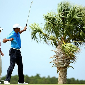 Tiger Woods reacts after making a putt on the third hole as Martin Kaymer looks on during Round Two of the 94th PGA Championship at the Ocean Course on August 10, 2012 in Kiawah Island, South Carolina.